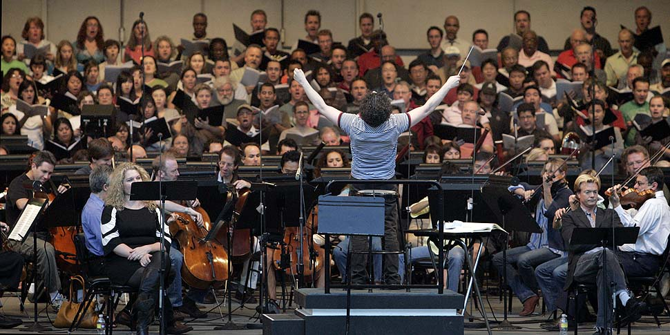 Los Angeles Philharmonic's Gustavo Dudamel rehearses with choral groups and soloists at the Hollywood Bowl before a 2009 performance, a tribute to the music director's first season with the L.A. Phil.