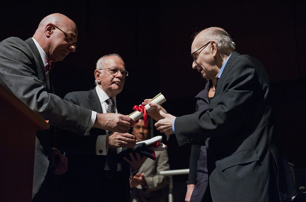 Leon Botstein, president of Bard College, left, presents Maestro JosŽ Antonio Abreu, founder of El Sistema, an honorary doctorate degree Saturday September 20, 2014, at The Richard B. Fisher Center for the Performing Arts at Bard College in Annandale-on-Hudson, N.Y. At center is Dimitri Papadimitriou. executive vice president of the College. (Karl Rabe photo)